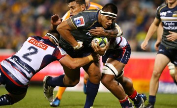 Allan Alaalatoa of the Brumbies is tackled during the round 15 Super Rugby match between the Brumbies and the Rebels