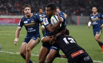Aidan Toua of the Brumbies (L) is tackled by Berton Klaasen of the Southern Kings (R) during the Super Rugby match between the Southern Kings and Brumbies