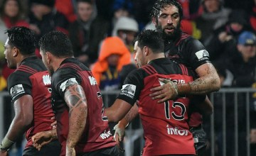 : Samuel Whitelock of the Crusaders (R) and his team mates celebrate scoring a try during the Super Rugby Quarter Final