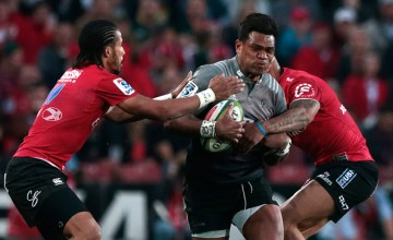 Crusaders Pete Samu (C) is tackled by Lions Courtnall Skosan (L) during the Super XV rugby final