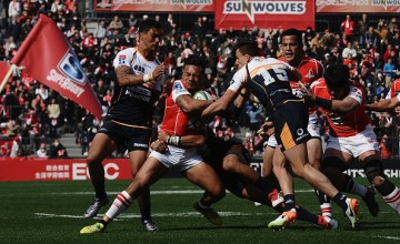 Lomano Lava Lemeki of the Sunwolves is tackled during the Super Rugby round 2 match between Sunwolves and Brumbies