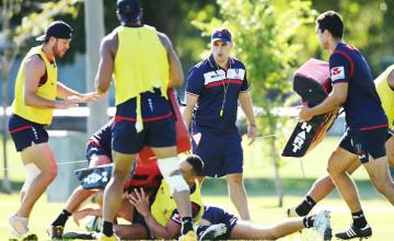 Head coach David Wessels instructs players during a Melbourne Rebels Super Rugby training session at Gosch's Paddock