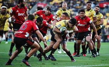 Chris Eves of the Hurricanes dives over to score a try during the round four Super Rugby match between the Hurricanes and the Crusaders