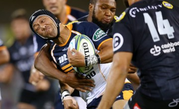 Christian Lealiifano of the Brumbies is tackled during the round five Super Rugby match between the Brumbies and the Sharks