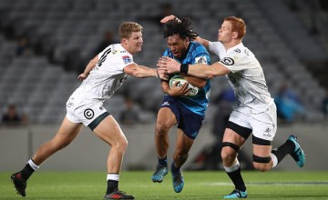 TJ Faiane of the Blues is tackled during the round sevens Super Rugby match between the Blues and the Sharks at Eden park