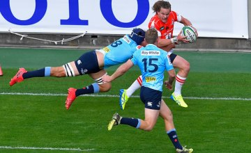 Michael Little of the Sunwolves is tackled by Michael Wells of the Waratahs during the Super Rugby match between Sunwolves and Waratahs at Prince Chichibu Memorial Ground