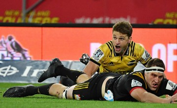 Beauden Barrett of the Hurricanes reacts to scoring during the round nine Super Rugby match between the Hurricanes and the Chiefs