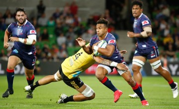 Will Genia of the Rebels runs with the ball during the round seven Super Rugby match between the Rebels and the Hurricanes