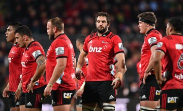 Captain Samuel Whitelock of the Crusaders (C) and his team mates react during the round 12 Super Rugby match between the Crusaders and the Waratahs