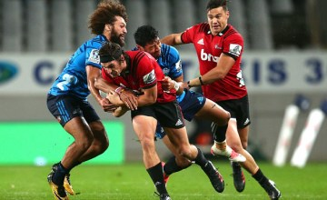 George Bridge of the Crusaders makes a break during the round 14 Super Rugby match between the Blues and the Crusaders at Eden Park