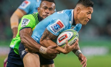 Israel Folau of the Waratahs is tackled by Highlanders Tevita Nebura during the round 14 Super Rugby match between the Waratahs and the Highlanders