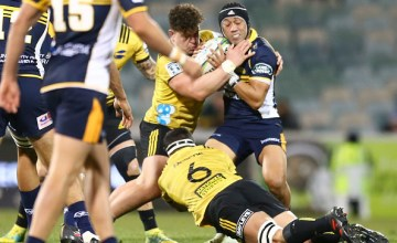 Hurricanes hooker Ricky Riccitelli and Brumbies number 10 Christian Lealiifano wrestle for the ball in a Canberra Super rugby match