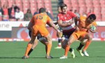 Lions' Harold Vorster (C) tackles Jaguares' Matias Orlando (R) during the Super Rugby match between the Emirates Lions and the Jaguares.