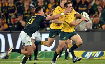 Bernard Foley of the Wallabies is pursued by Jesse Kriel of the Springboks during the Rugby Championship 2017 match between South Africa and Australia