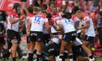 The Lions celebrate victory over the Melbourne Rebels after Lombard's winner