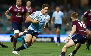 Alex Newsome races away for a try to win the game for the Waratahs over their old foes the Reds
