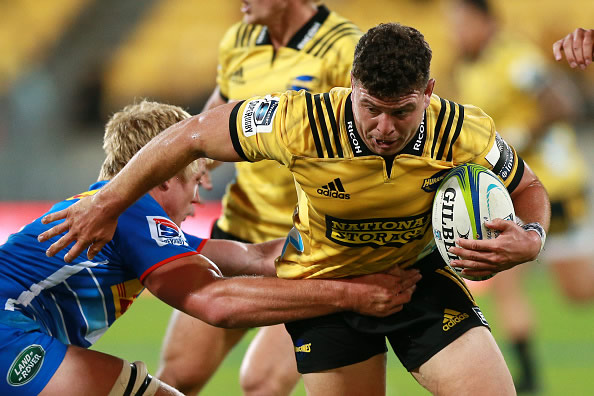 Ricky Riccitelli of the Hurricanes is tackled by Pieter-Steph du Toit of the Stormers during the round six Super Rugby match between the Hurricanes and the Stormers at Westpac Stadium