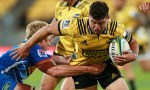Ricky Riccitelli of the Hurricanes is tackled by Pieter-Steph du Toit of the Stormers nduring the round six Super Rugby match between the Hurricanes and the Stormers at Westpac Stadium