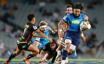 Ma'a Nonu of the Blues makes a run against Eben Etzebeth of the Stormers during the round 7 Super Rugby match between the Blues and the Stormers at Eden Park
