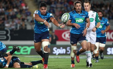 Tanielu Tele'a of the Blues clears the ball
