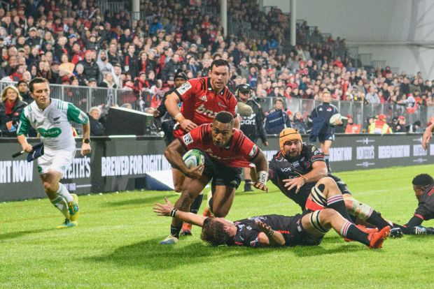 Sevu Reece of the Crusaders runs through to score a try during the round 11 Super Rugby match between the Crusaders and Lions at Christchurch Stadium