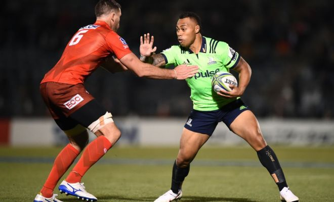Tevita Li of the Highlanders hands off Grant Hattingh of the Sunwolves during the round 11 Super Rugby match between Sunwolves and Highlanders