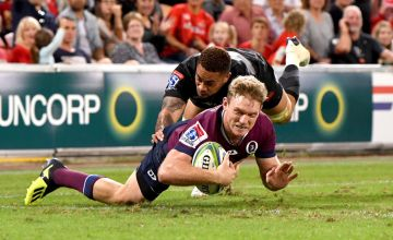 Bryce Hegarty of the Reds scores a try during the round 12 Super Rugby match between the Reds and the Sunwolves at Suncorp Stadium