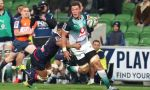 Hanro Liebenberg of the Bulls runs with the ball while being tackled by Rebels defence during the round 14 Super Rugby match between the Rebels and Bulls at AAMI Park