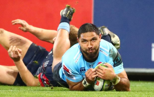 Curtis Rona of the Waratahs scores a try