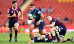 Augustine Pulu on the way to his second try in the Blues' Super Rugby win over the Reds at Suncorp Stadium, Brisbane