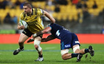 Dane Coles of the Hurricanes is tackled by Scott Scrafton of the Blues during the round 18 Super Rugby match between the Hurricanes and the Blues at Westpac Stadium