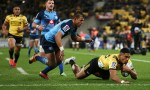 Salesi Rayasi of the Hurricanes beats Handre Pollard of the Bulls to score a try during the Super Rugby Quarter Final match between the Hurricanes and the Bulls at Westpac Stadium