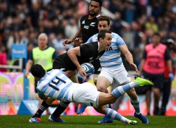 Ben Smith of New Zealand is tackled by Matias Moroni