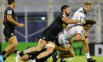 George Bridge of Crusaders is tackled by Ramiro Moyano and Javier Ortega Desio of Jaguares during a match between Jaguares and Crusaders