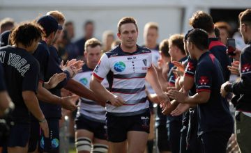 Dane-Haylett-Petty leads the Rebels on to the field