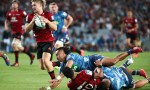 Jack Goodhue of the Crusaders makes a break to score a try (L) during the round 3 Super Rugby match between the Blues and the Crusaders