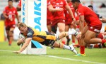 Will Miller dives over under the posts as the Brumbies batter the struggling Sunwolves 14-47 at a windy WIN Stadium, Wollongong