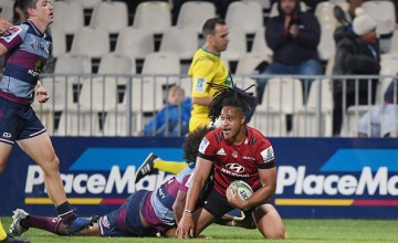 (Leicester Faingaanuku celebrates scoring the Crusaders' third try in their 24-20 win over the Queensland Reds at Orangetheory Stadium, Christchurch