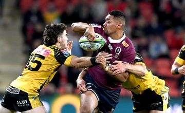 Chris Feauia-Sautia of the Reds attempts to offload during the round three Super Rugby AU match between the Reds and Force at Suncorp Stadium