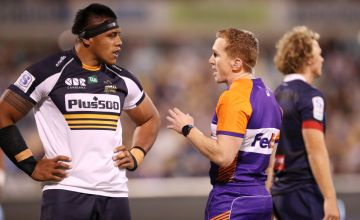 Sio of the Brumbies talks to the referee Nic Berry