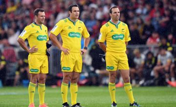 Assistant Referee James Doleman, Referee Ben O'Keeffe and Assistant Referee Mike Fraser (L-R) look on
