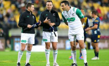 Referee Ben O'Keeffe (R) confers with assistant referees James Doleman and Paul Williams