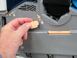 Turn the release lever on the left side of the Drum Cartridge Cover