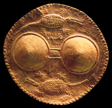 beaten gold pectoral with female breasts