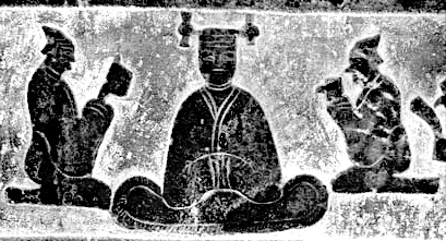 seated goddess wearing the sheng headdress, with knobs at both ends