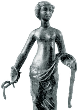woman barebreasted holding coiling serpents, in bronze