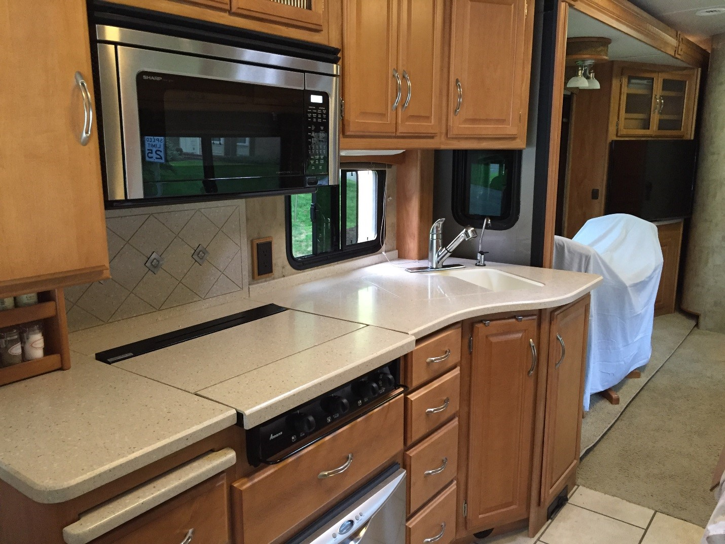 A Full View Of The RV Kitchen Countertops Before Our Watermist Refinish