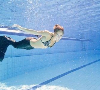 adult mermaid woman in pool