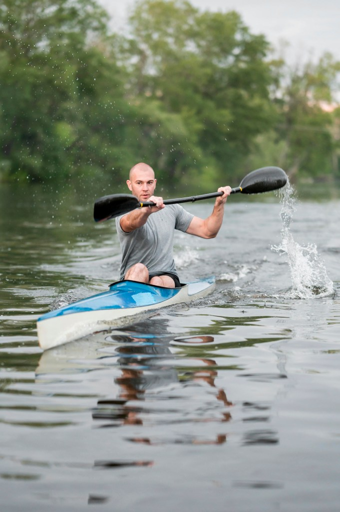 Man rowing kayak