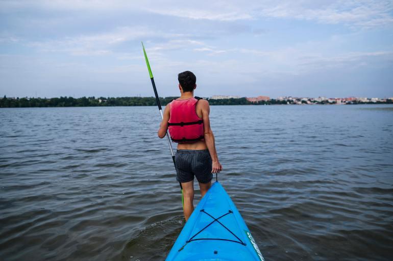 man pulling kayak